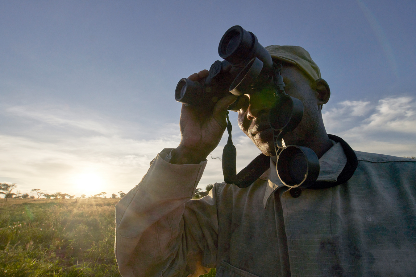 A community game scout monitors wildlife in Tanzania