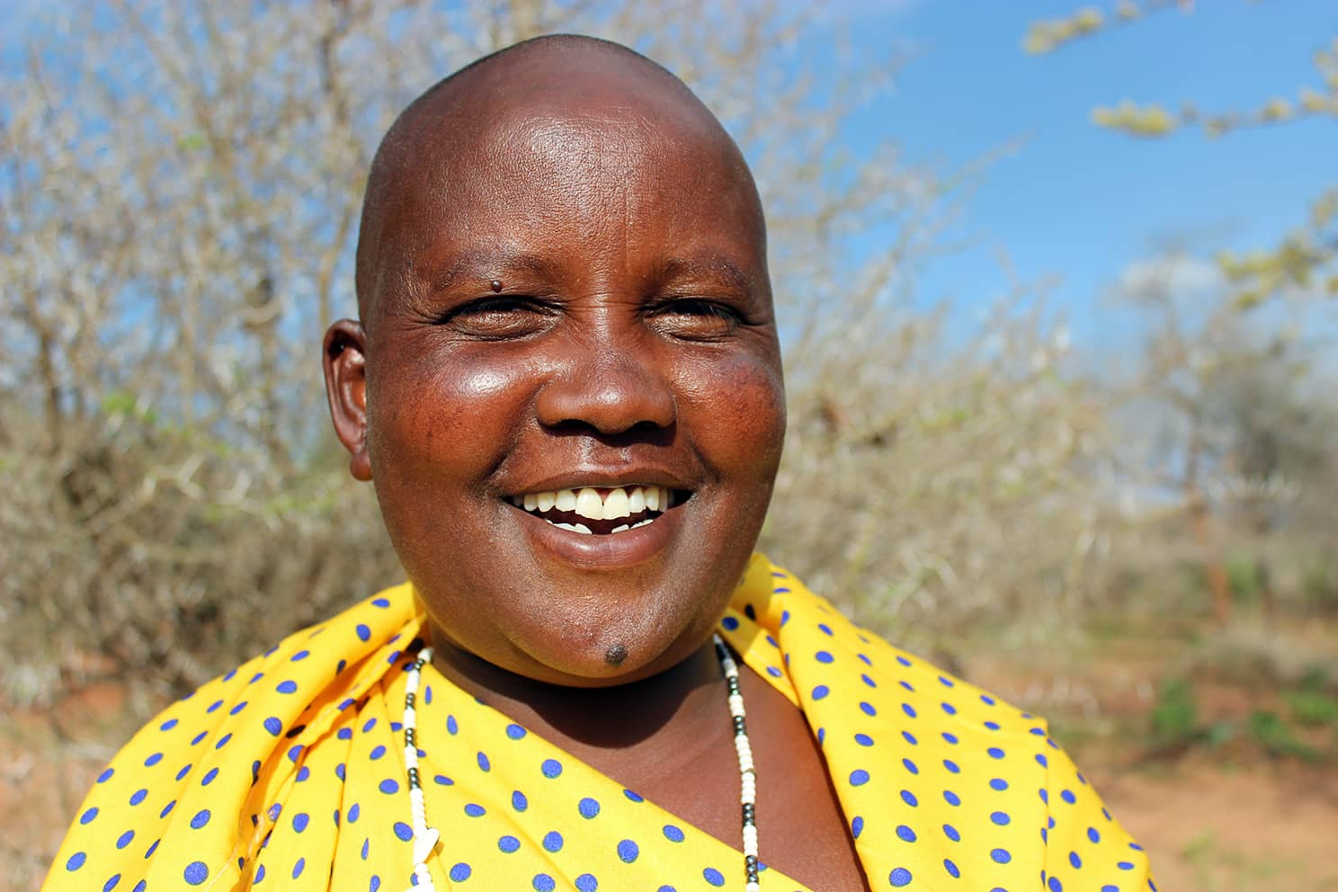 An African woman smiling