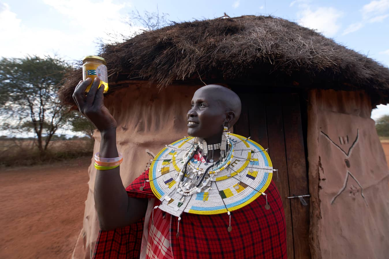 Maasai-woman-with-honey